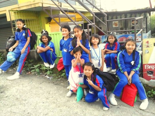 Children are waiting for their school bus.