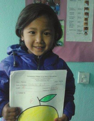 SABITA,Class-Nursery happily showing her art-A+.