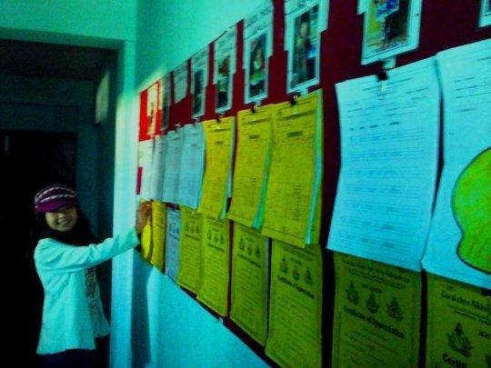 PRIYA,Class-7 happy with displayboard at childhome