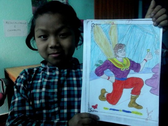 Dolma, Class-3 is happily demonstrating her  art.