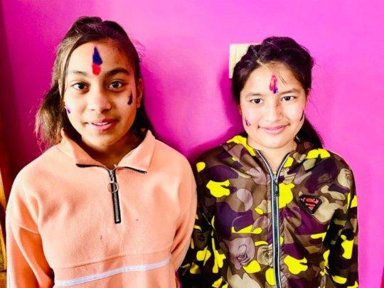 Saraswati and Karisma celebrating Holi with colors