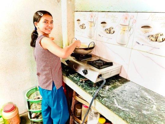 Srijana, class-5 practicing cooking.