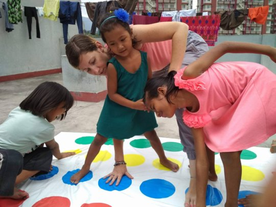LEILA and children are enjoying on Twister-Game.
