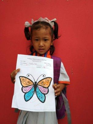 SABITA,Class-LKG received A+ on art works.