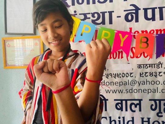 Roshani happy with sacred thread at RakshyaBandhan