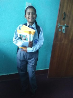 Karishma is happy with school dress from BEATRICE.