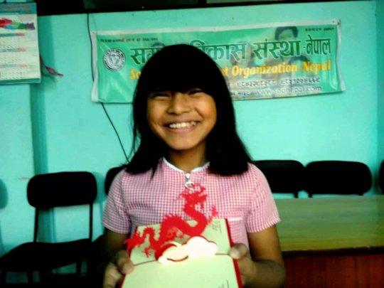 Srijana with her award receiving full-mark on MATH