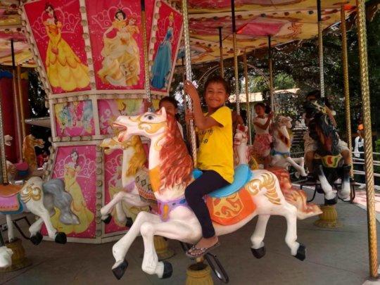 Children enjoying on horse riding at Fun-Park.