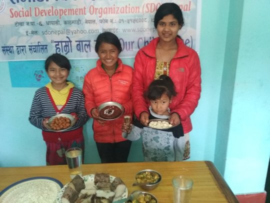 Children happy with sweets at  Maghe Sakranti fest