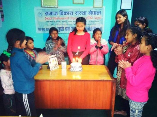 Priya,  happily  celebrating her 15th Birthday .