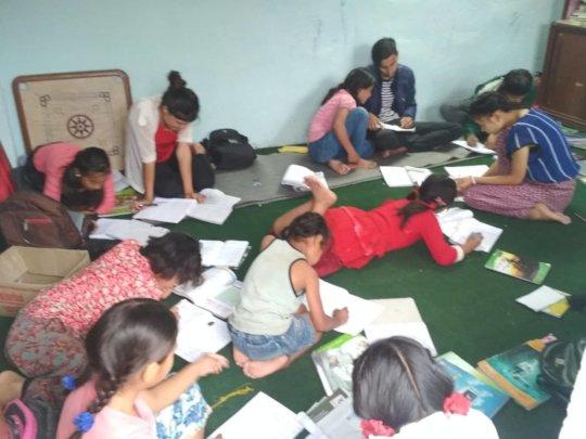 Children busy on 1st-term exam preparation.