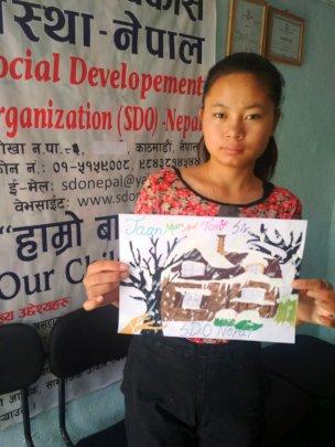 Priya  class-10 displaying her art work to present