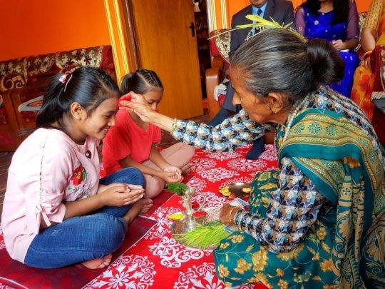 Children celebrating Dashain with TIKA(color)