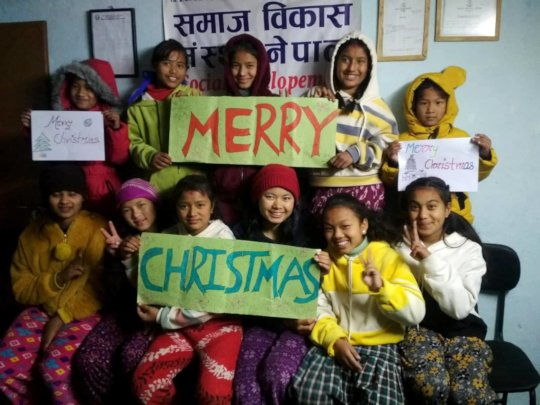 Children wishing MERRY-CHRISTMAS to all supporters