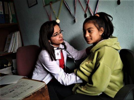 Dr. Swekchha on regular health checkup to children