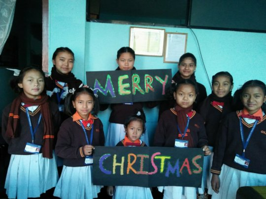 Children wishing Merry-Christmas from tiny hearts