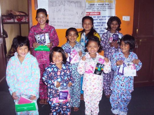 Children happy with Pyjama donated by Leila-Aus.
