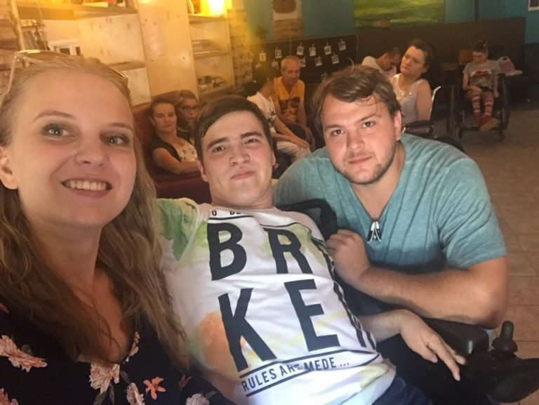 Nastya with Vlad (centre) from the social club