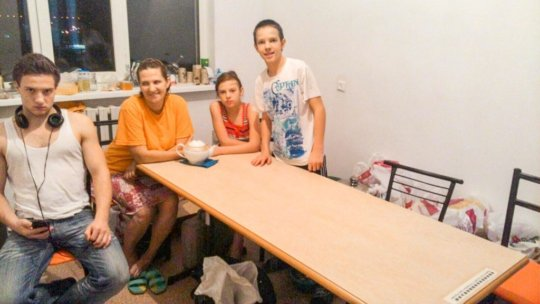 The Mamyrbaev family with their new furniture