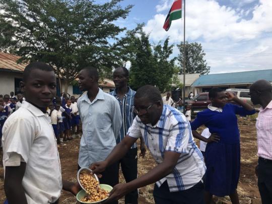 Leonard Otieno Otiende serving food to Class 8