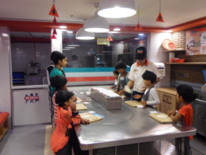 Making mouth-watering pizzas at KidZania!