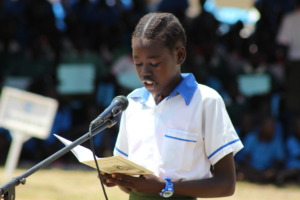 Young girl reads story out loud at ILD 2015 event