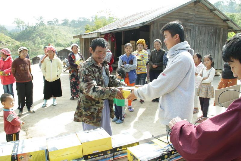 Each household representative receives a lantern