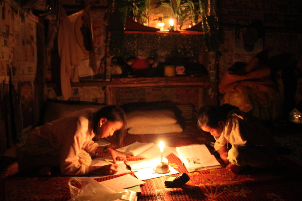 Children studying by candlelight