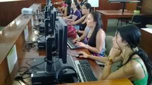 Some students using a computer for the first time
