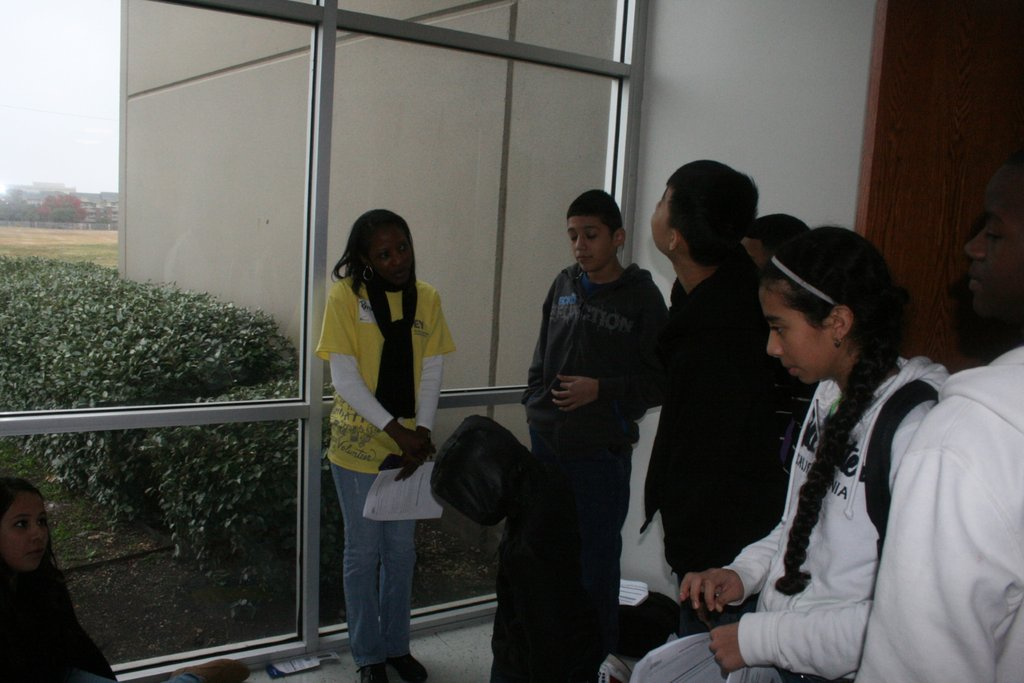 an EY volunteer working with students