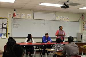 local business mentors speaking in a NFTE class
