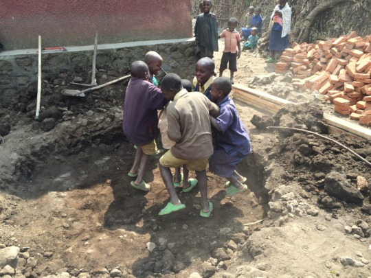 Local kids helping out by packing down dirt