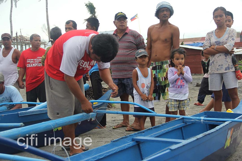 Fisher folks assemble their new fishing boats