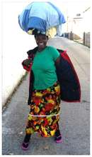 Agnes carrying clothes home