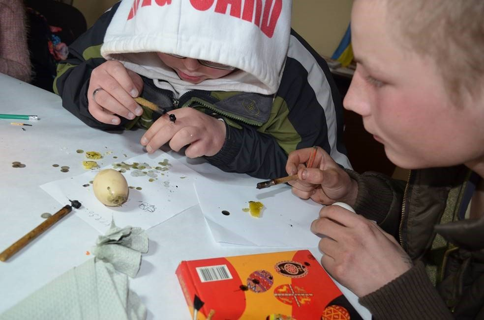 Practicing traditional ornamenting of Easter eggs