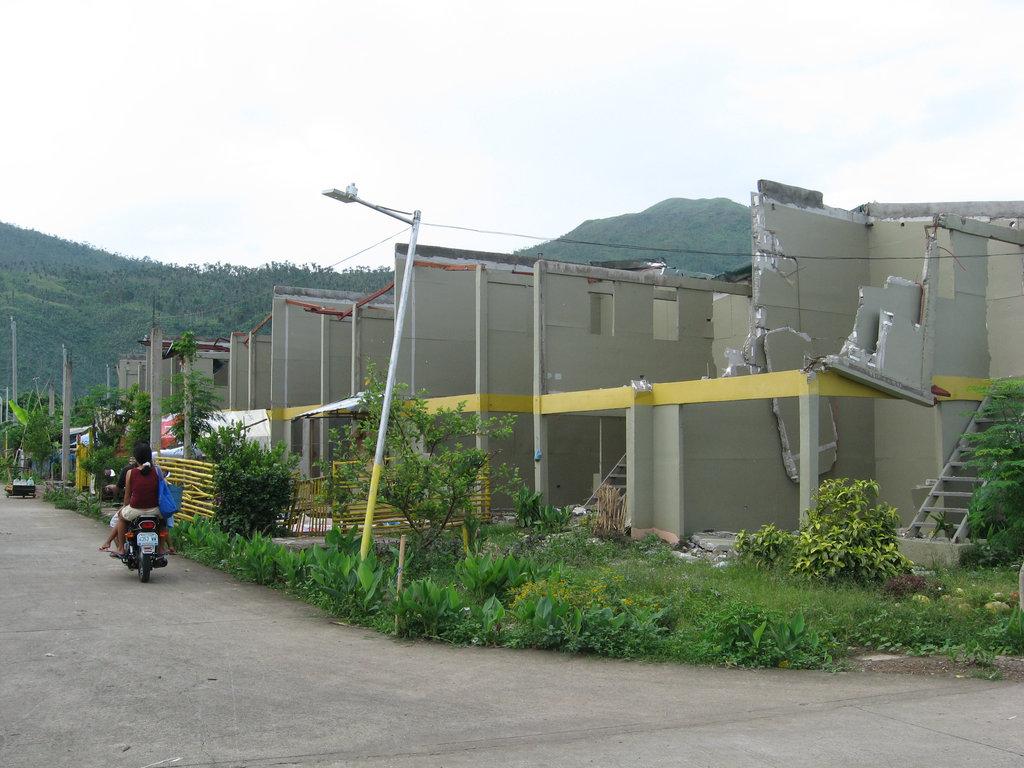 resettlement complex destroyed in Typhoon Glenda