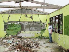 Eric inspecting damaged schools