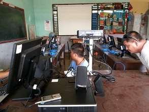 technicians install HP computers in e-classroom