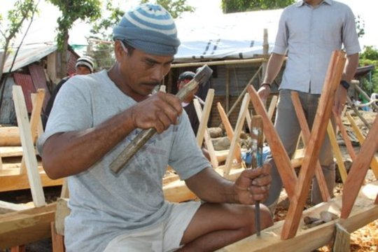 Boat building craftsman creates fishing craft