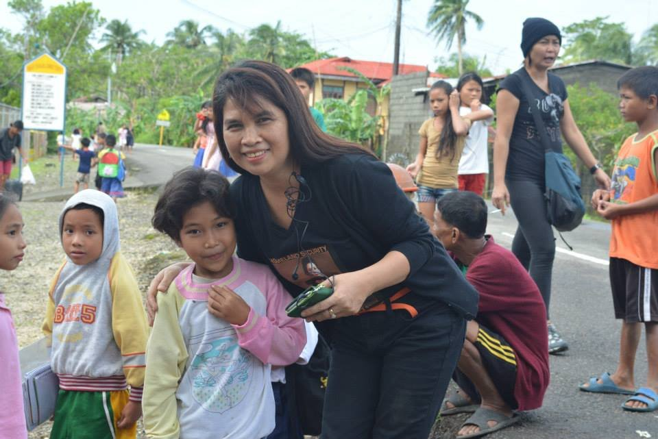 Lourdes Damazo with school child in Borongan