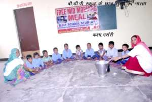 Less privileged students getting mid morning meal