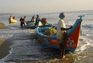 Fishermen with new boats in Tamil Nadu