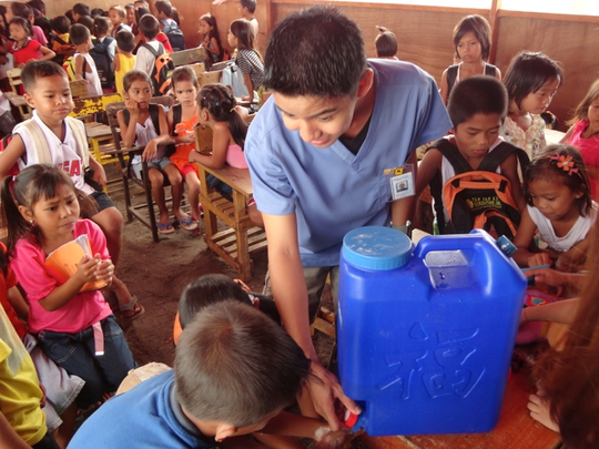 Demonstrating proper hand washing techniques