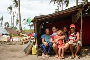 Sara and her family in makeshift shelter