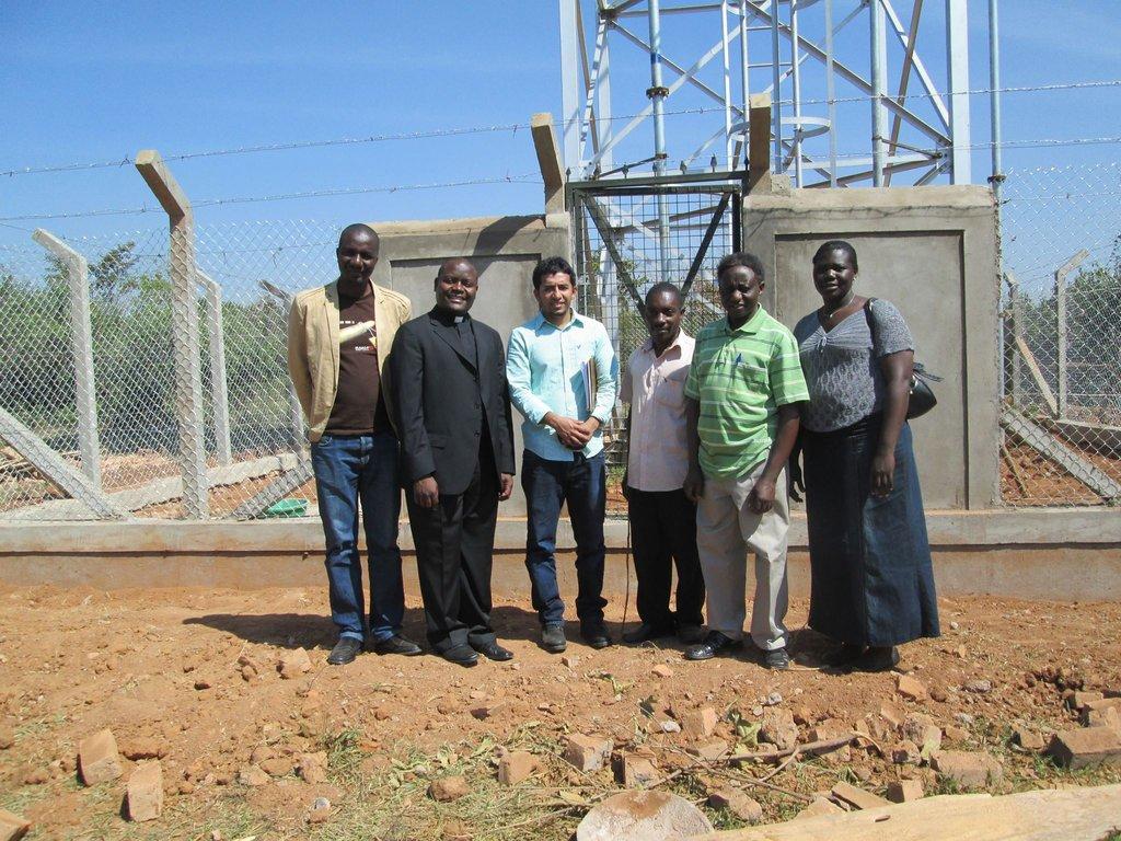 Nasir Uddin and Ugandan team visit water tower.
