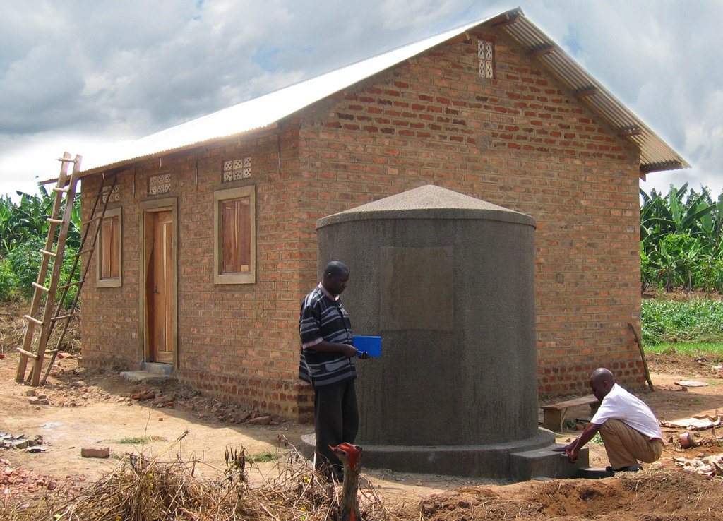 Rain harvesting tank and roof from metal sheets
