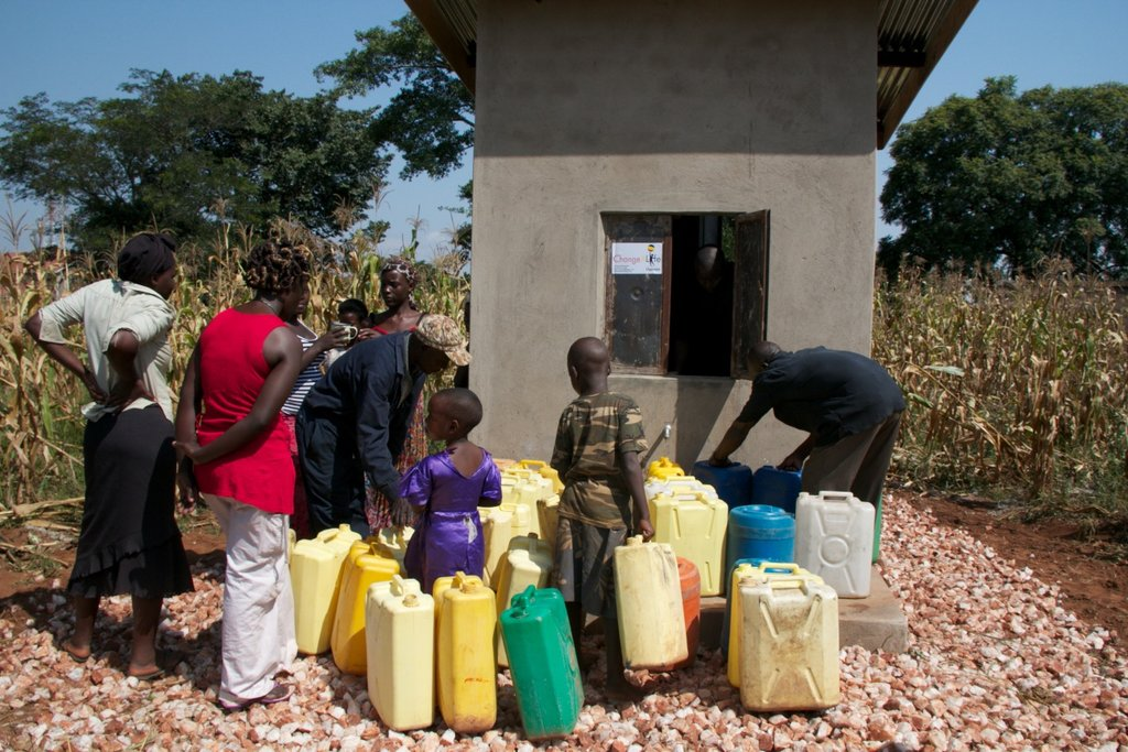The community gets water from the water kiosk.