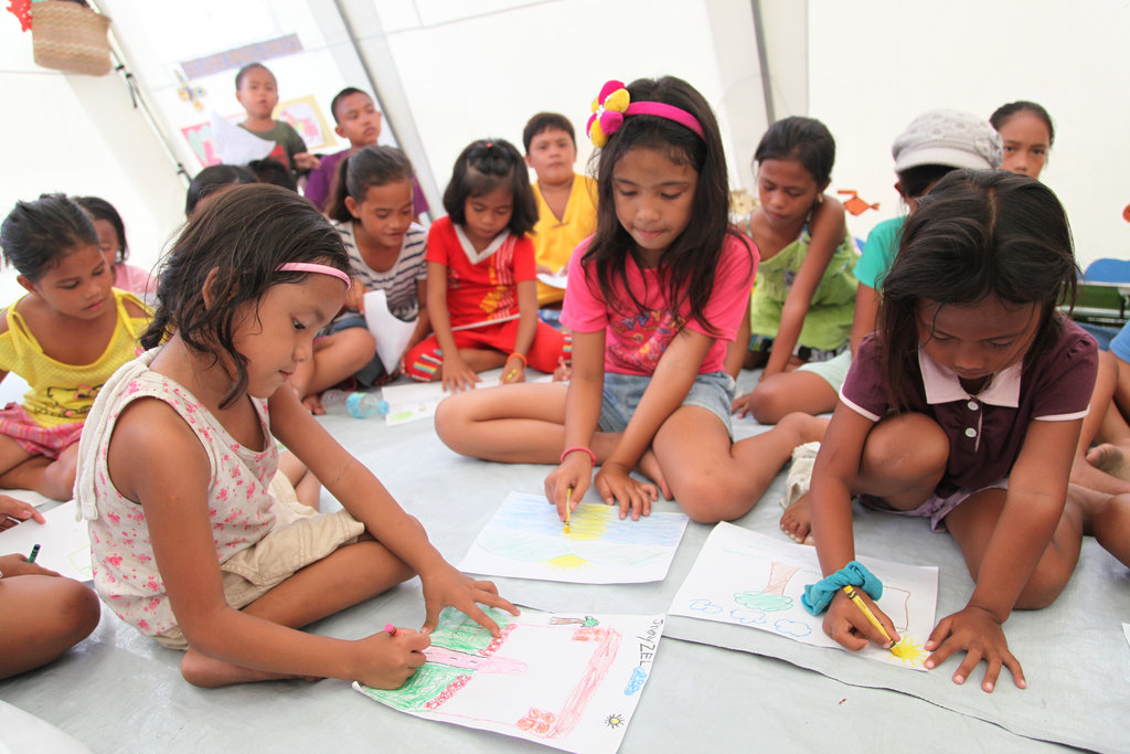 Coloring in a child-friendly space in Tacloban.
