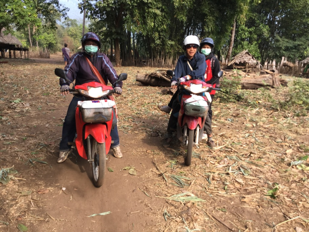 The boys on the bikes between villages