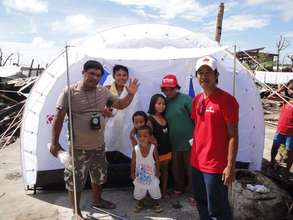 A family in Guiuan, Samar receives a tent from CF